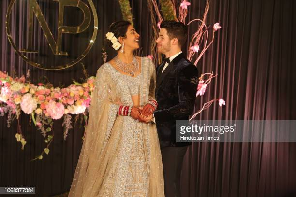 Newlywed Bollywood actor Priyanka Chopra and American singer Nick Jonas pose for photos during their wedding reception at Taj Palace on December 4...