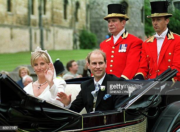 Newly-wed British royal couple Prince Edward and Sophie Rhys-Jones wave to wellwishers as their carriage leaves Windsor Castle 19 June 1999. The...