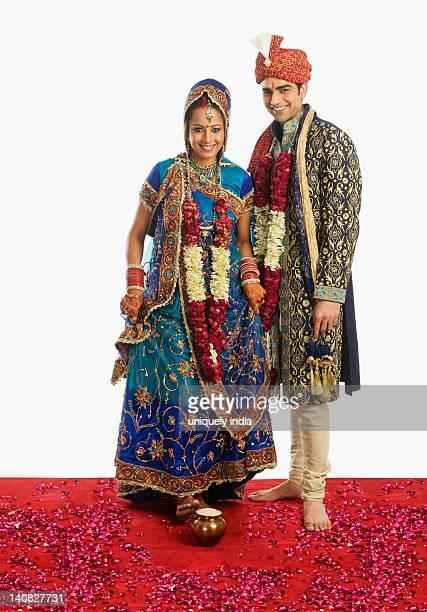 Newlywed couple at Griha Pravesh ceremony