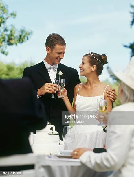 newlywed couple at their wedding reception - smoking stockfoto's en -beelden