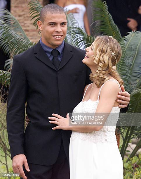 Newlywed couple Brazilian soccer star Ronaldo Nazario and Milena Rodriguespose for photographs at the end of a private wedding ceremony at the house...