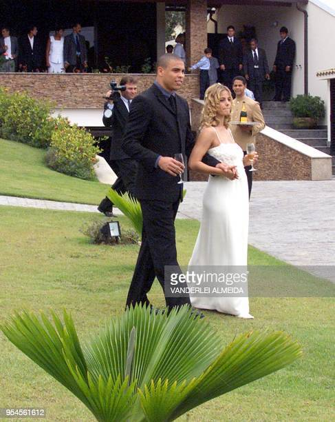 Newlywed couple Brazilian soccer star Ronaldo Nazario and Milena Rodrigues walk through the gardens at the end of a private wedding ceremony at the...