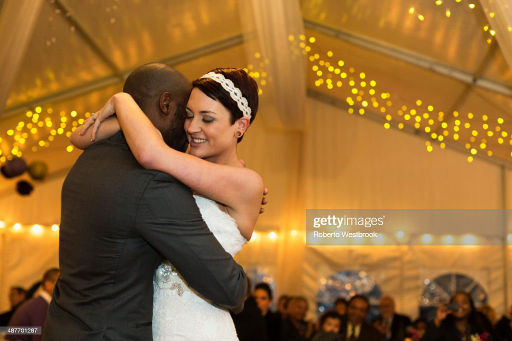 Newlywed couple dancing at reception : Stock Photo