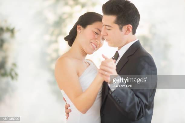 Newlywed couple dancing at wedding reception
