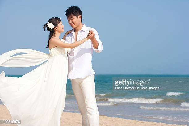 Newlywed Couple Dancing on the Beach