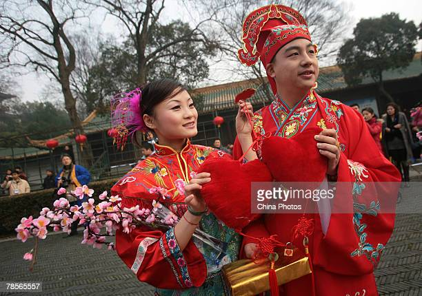 A Newlywed couple dressed in traditional costumes attend a Mingstyle collective wedding ceremony at the Chaotiangong Palace on December 19 2007 in...