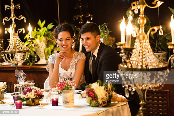 Newlywed couple having a dinner
