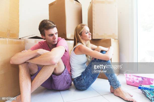 Newlywed couple having difficulties in deciding where to place things in their new home, leading to them being at odds with one another