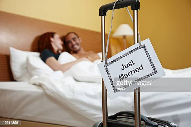 Newlywed couple in honeymoon bed