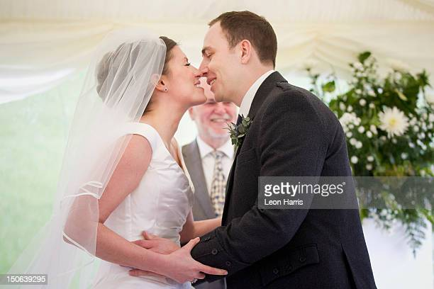 Newlywed couple kissing in wedding
