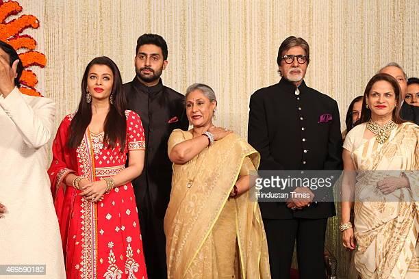 Newlywed couple Kunal Kapoor and Naina Bachchan pose with Brides uncle and Bollywood actor Amitabh Bachchan his wife Jaya Bachchan son Abhishek...