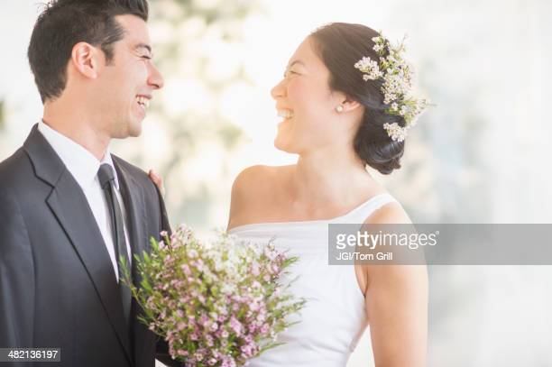 newlywed couple laughing - wedding ceremony stock photos and pictures