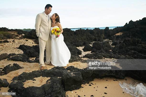 Newlywed Couple on Rocky Beach