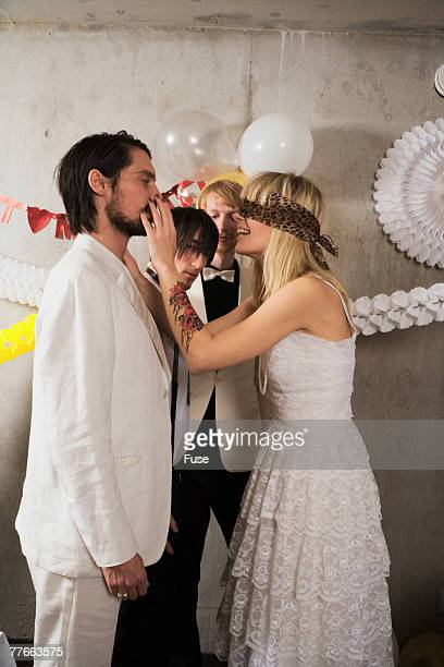 newlywed couple playing party game - blindfolded bride stock pictures, royalty-free photos & images