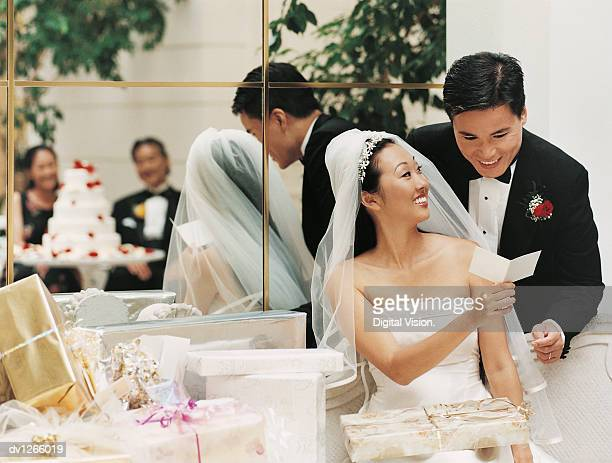 Newlywed Couple Reading a Greeting Card