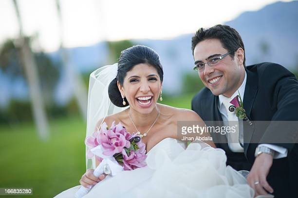 newlywed couple smiling on golf course - lebanese ethnicity stock photos and pictures