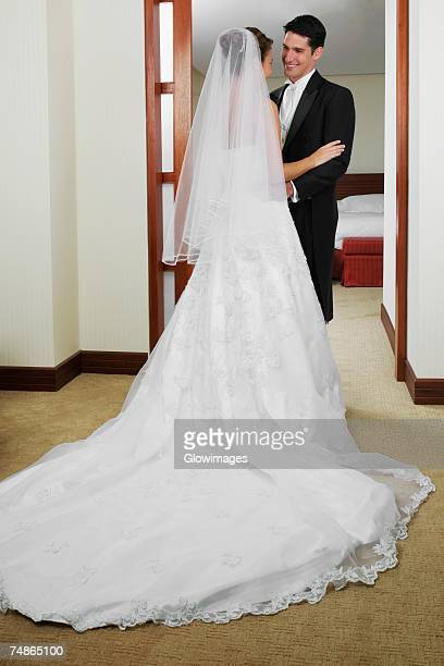 Newlywed couple standing and looking at each other