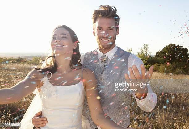 Newlywed couple walking in confetti