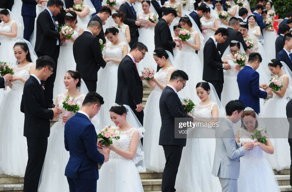 108 newly weds attend group wedding ceremony in hangzhou photos and newly wed couples attend a group wedding ceremony before international workers day on april junglespirit Image collections