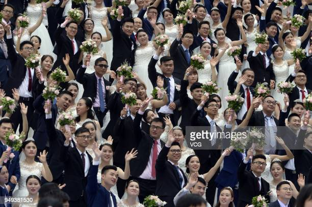 Newlywed couples attend a group wedding ceremony before International Workers' Day on April 21 2018 in Hangzhou Zhejiang Province of China 108 pairs...