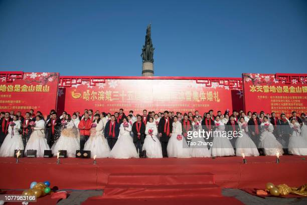 Newlywed couples attends their group wedding ceremony as part of the 35nd Harbin International Ice and Snow Festival on January 5 2019 in Harbin China