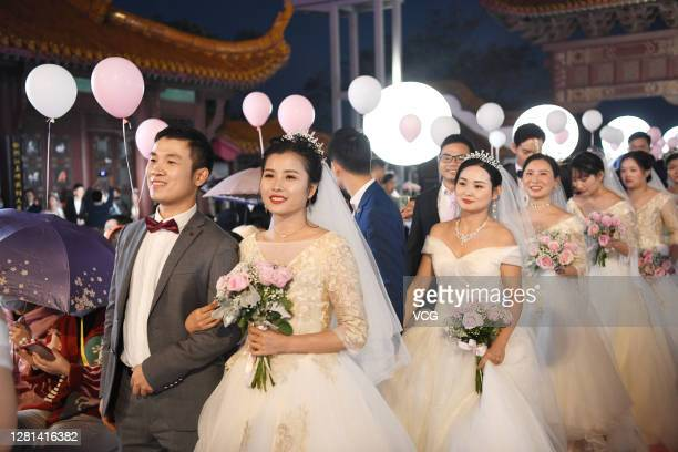 Newly-wed couples from Wuhan Union Hospital attend a group wedding at the Yellow Crane Tower on October 20, 2020 in Wuhan, Hubei Province of China....