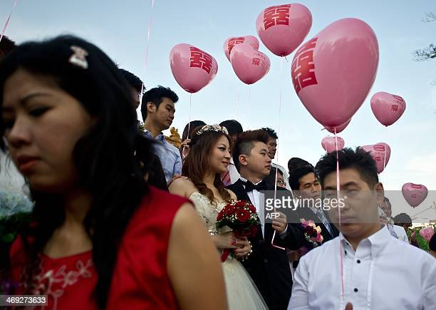 Newlywed Ethnic MalaysianChinese Couples Walk Out To Pose For Photographs During Their Mass Wedding Ceremony On