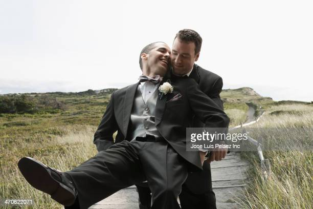 Newlywed grooms on bicycle outdoors