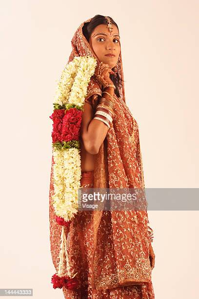 Newlywed Indian bride holding a garland
