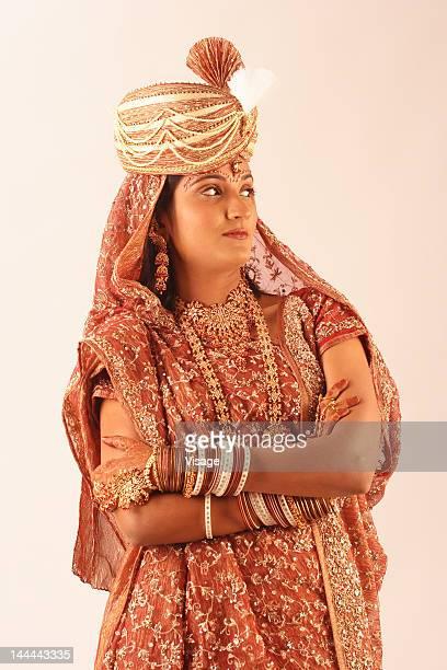 Newlywed Indian bride wearing the bridegroom's turban