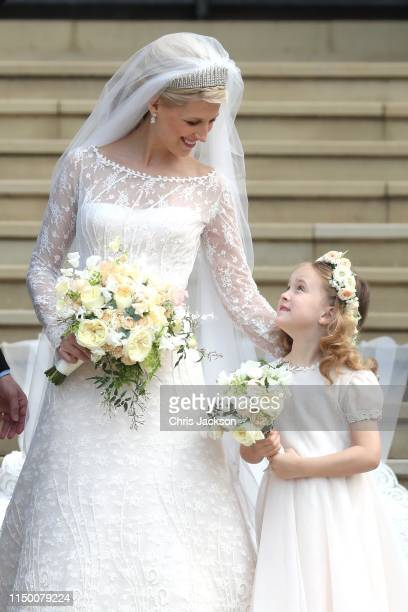 Newlywed Lady Gabriella Windsor with a young bridesmaid on the steps of the chapel after her wedding to Mr Thomas Kingston at St George's Chapel on...