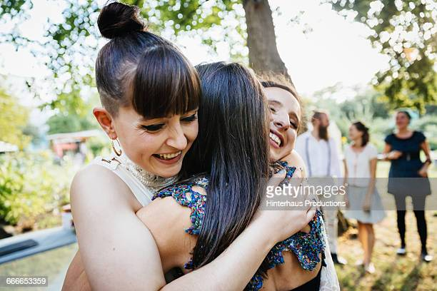 Newlywed lesbian couple being congratulated