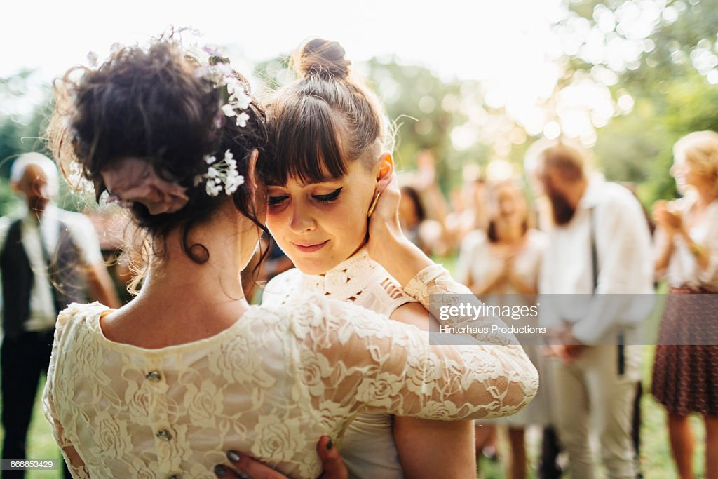 Newlywed lesbian couple dancing : Stock Photo