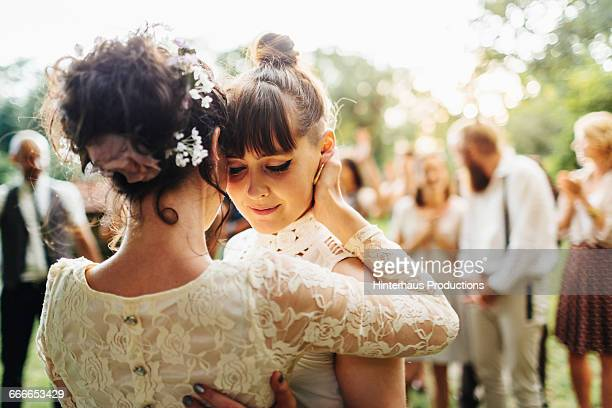 newlywed lesbian couple dancing - wedding stock pictures, royalty-free photos & images