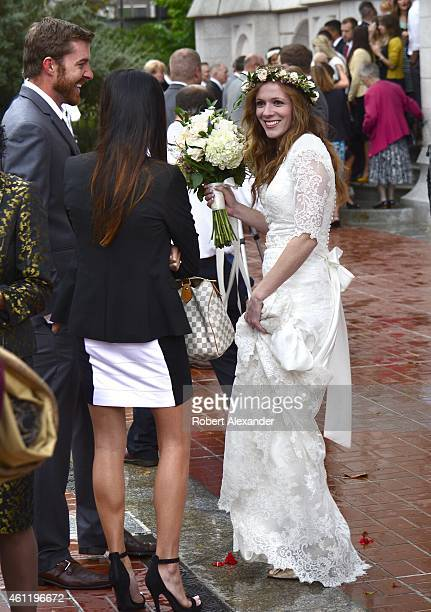 A newlywed Mormon bride talks with wedding guests after her wedding ceremony in the Salt Lake Mormon Temple in Salt Lake City Utah