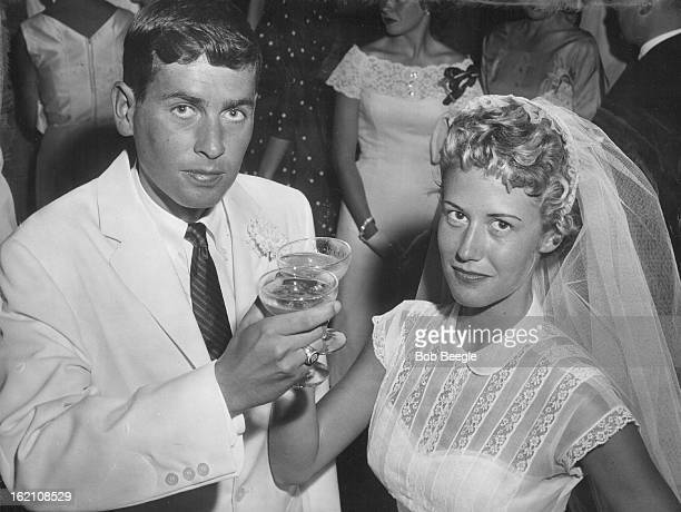 AUG 6 1956 AUG 12 1956 Newlywed Mr and Mrs Russell Writer Jr drink a champagne toast following their marriage on Monday at the home of her parents Mr...