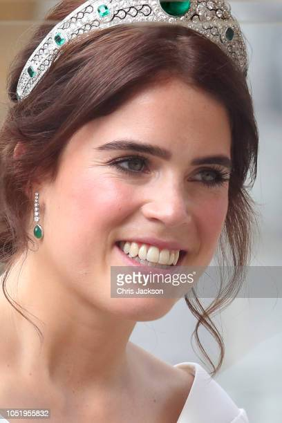 Newlywed Princess Eugenie of York smiles from her carriage after her Royal wedding to Mr Jack Brooksbank at St George's Chapel on October 12 2018 in...