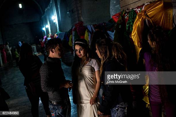 A newlywed Yazidi couple are seen inside the holiest temple of the Yazidi faith while attending friday rituals on November 11 2016 in Lalish Iraq...
