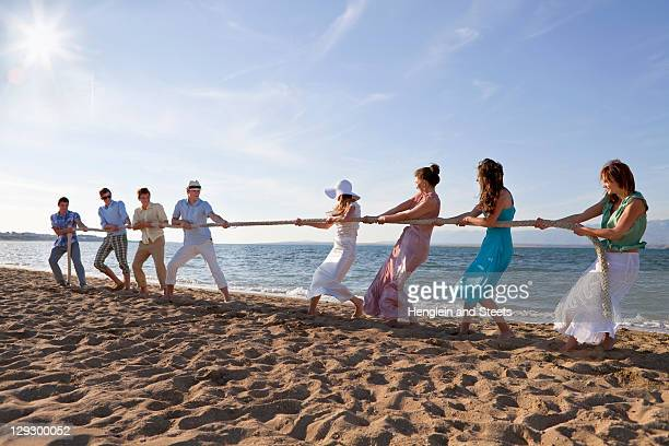 Newlyweds and guests playing tug of war