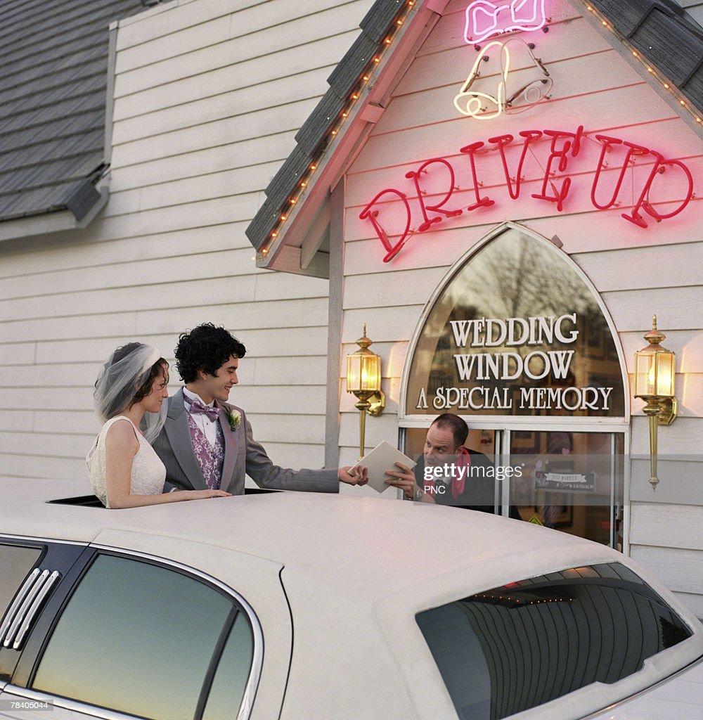 Newlyweds At Drive Thru Wedding Chapel Stock Photo