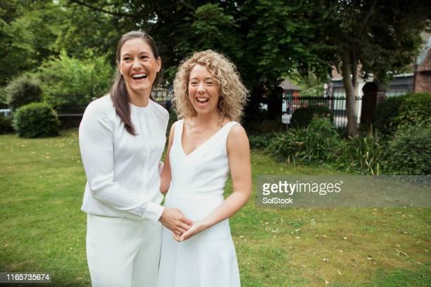 newlyweds celebrating! - civil partnership stock pictures, royalty-free photos & images