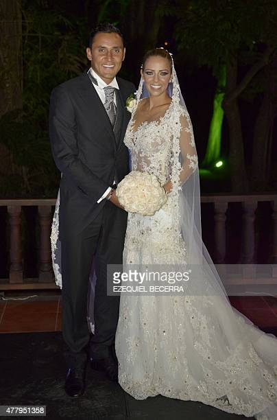 Newlyweds Costa Rican goalkeeper Keylor Navas and Andrea Salas pose while talking to the press on June 20 in San Antonio de Belen Navas plays for...