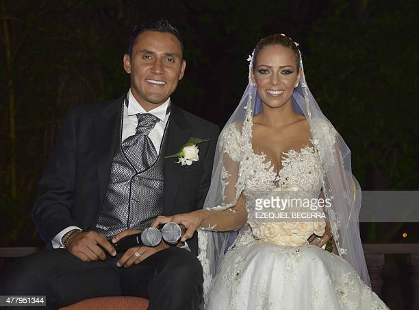 Newlyweds Costa Rican goalkeeper Keylor Navas and Andrea Salas talk to the press on June 20 in San Antonio de Belen Navas plays for Real Madrid