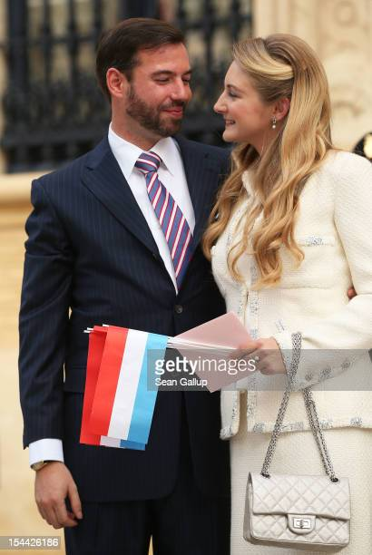 Newlyweds Crown Prince Guillaume and Princess Stephanie of Luxembourg walk towards the GrandDucal Palace following the civil ceremony for the wedding...