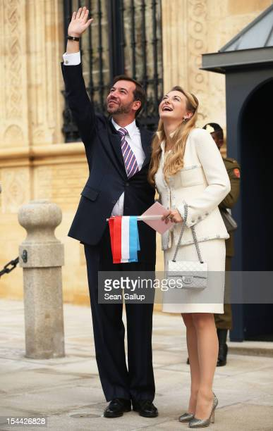 Newlyweds Crown Prince Guillaume and Princess Stephanie of Luxembourg wave to the crowds outside the GrandDucal Palace following the civil ceremony...