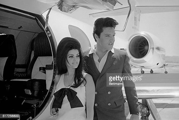 Newlyweds Elvis and Priscilla Presley, who met while Elvis was in the Army, prepare to board their private jet following their wedding at the Aladdin...