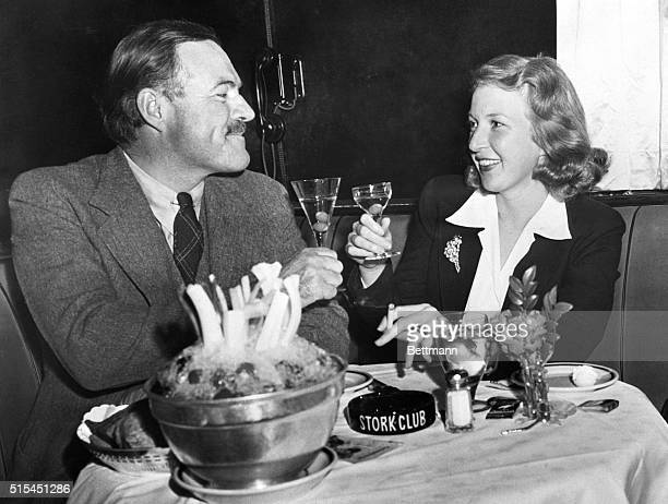 Newlyweds Ernest Hemingway and Martha Gelhorn make a toast at the Stork Club.