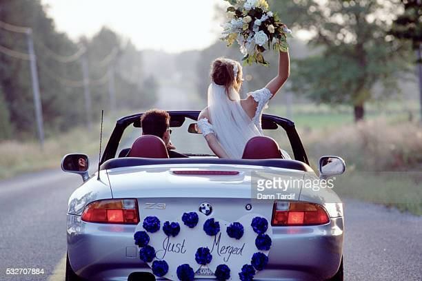 Newlyweds in a convertible