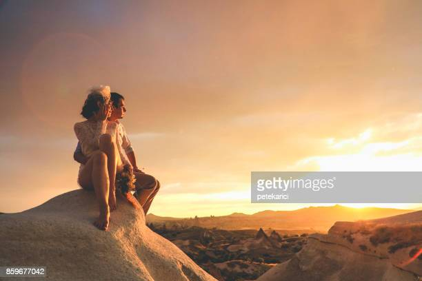 newlyweds in cappadocia, turkey - central anatolia stock photos and pictures