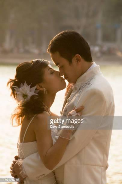 Newlyweds kissing, Hanoi, Vietnam